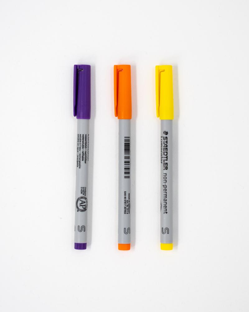 Set of 3 wet erase pens in purple, orange and yellow
