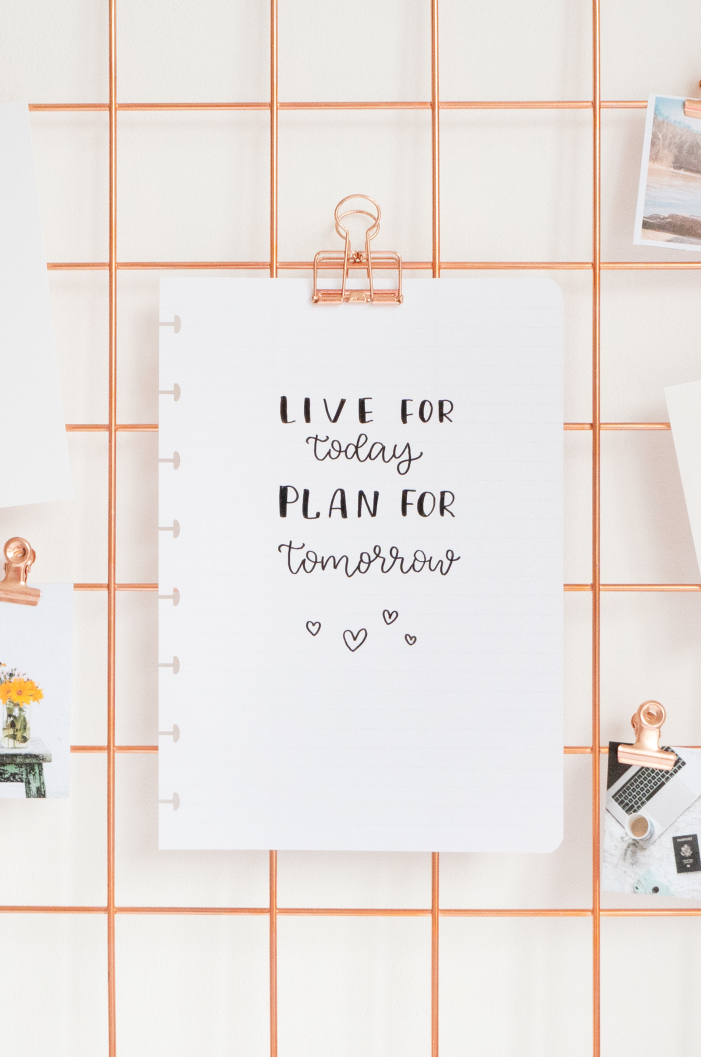 Quote on lined erasable page hanging on rose clipboard
