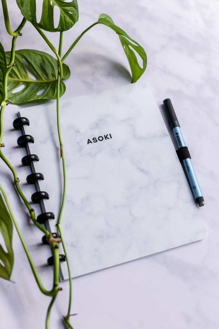 Asoki planner with marble cover and pen loop on marble background