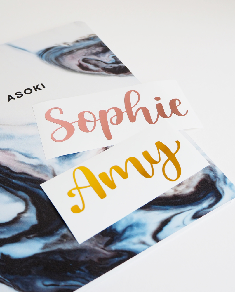 Marble-blue Asoki notebook with different custom calligraphy foil name stickers on top