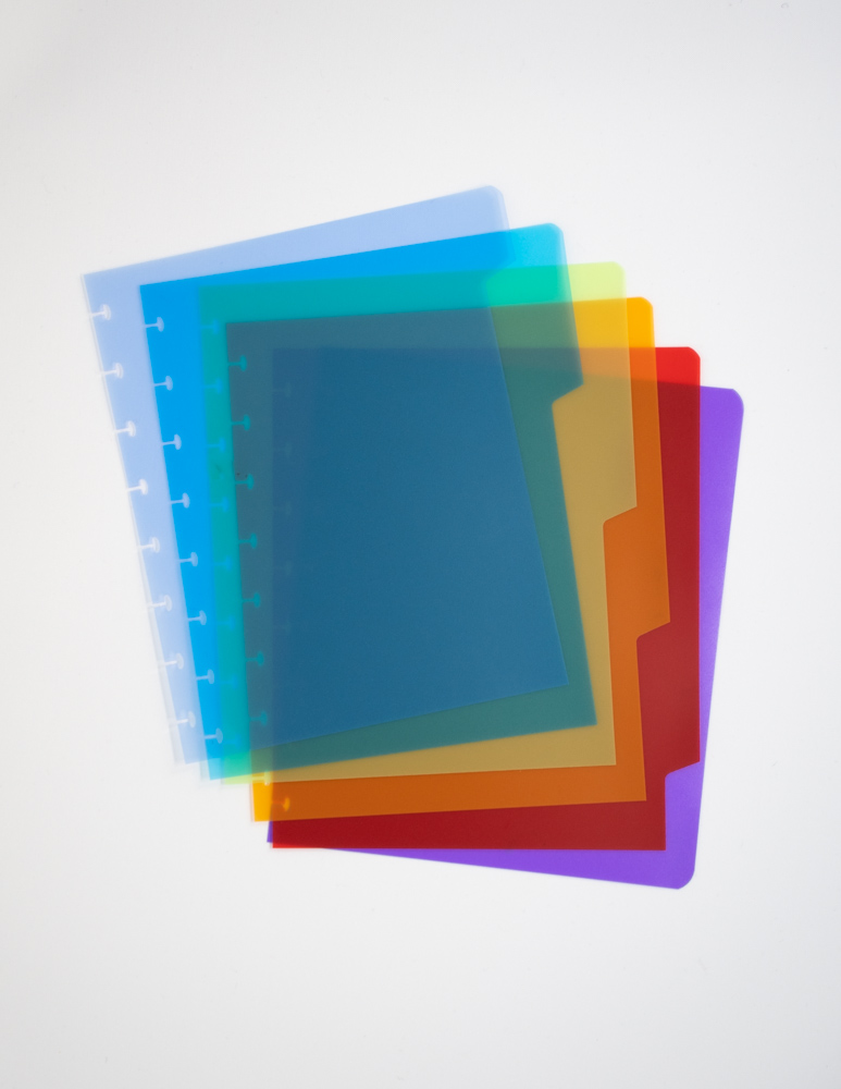 Reusable notebook dividers in six different colors on grey background