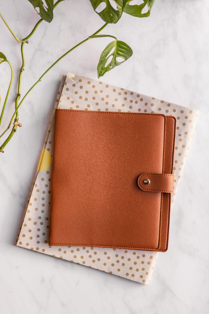 Brown, leather-free cover for the reusable and erasable Asoki Planner, plastic-free packaged