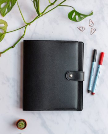 Black, animal-free cover with button for the reusable Asoki Planner