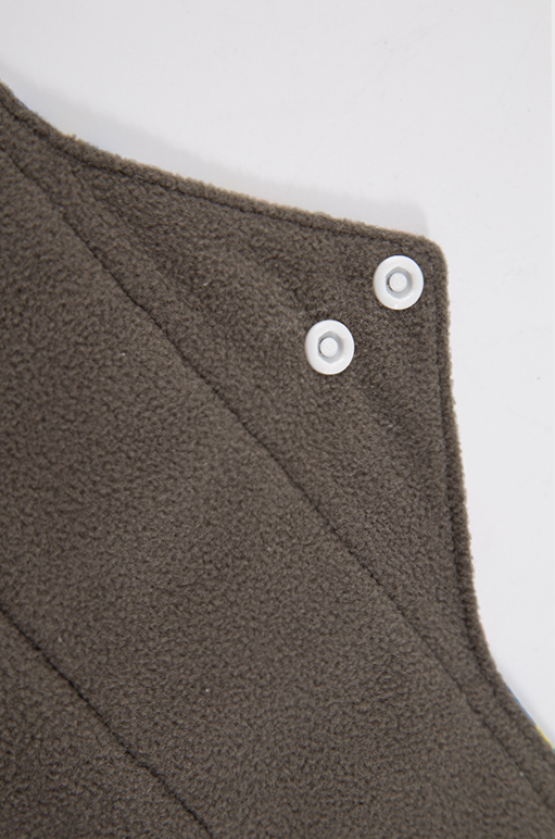 Reusable period pad fleece in dark grey with white buttons