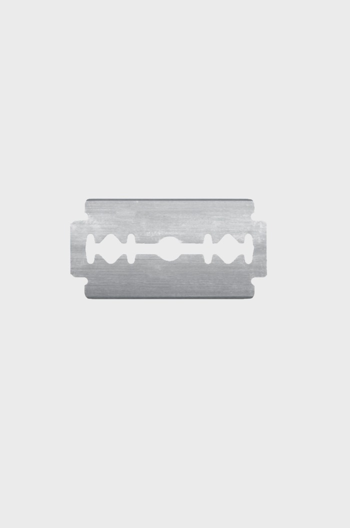 Metal safety razor blade on white background