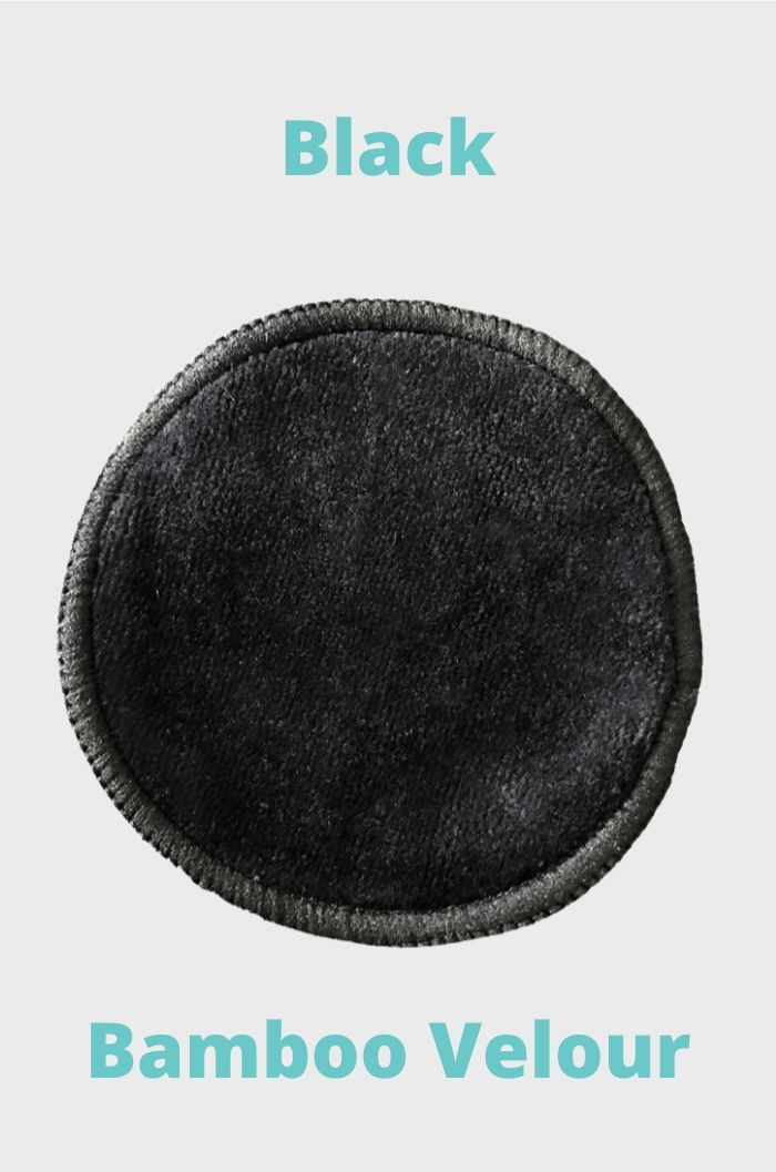 Round black reusable make-up remover pad made of bamboo and blue text on grey background