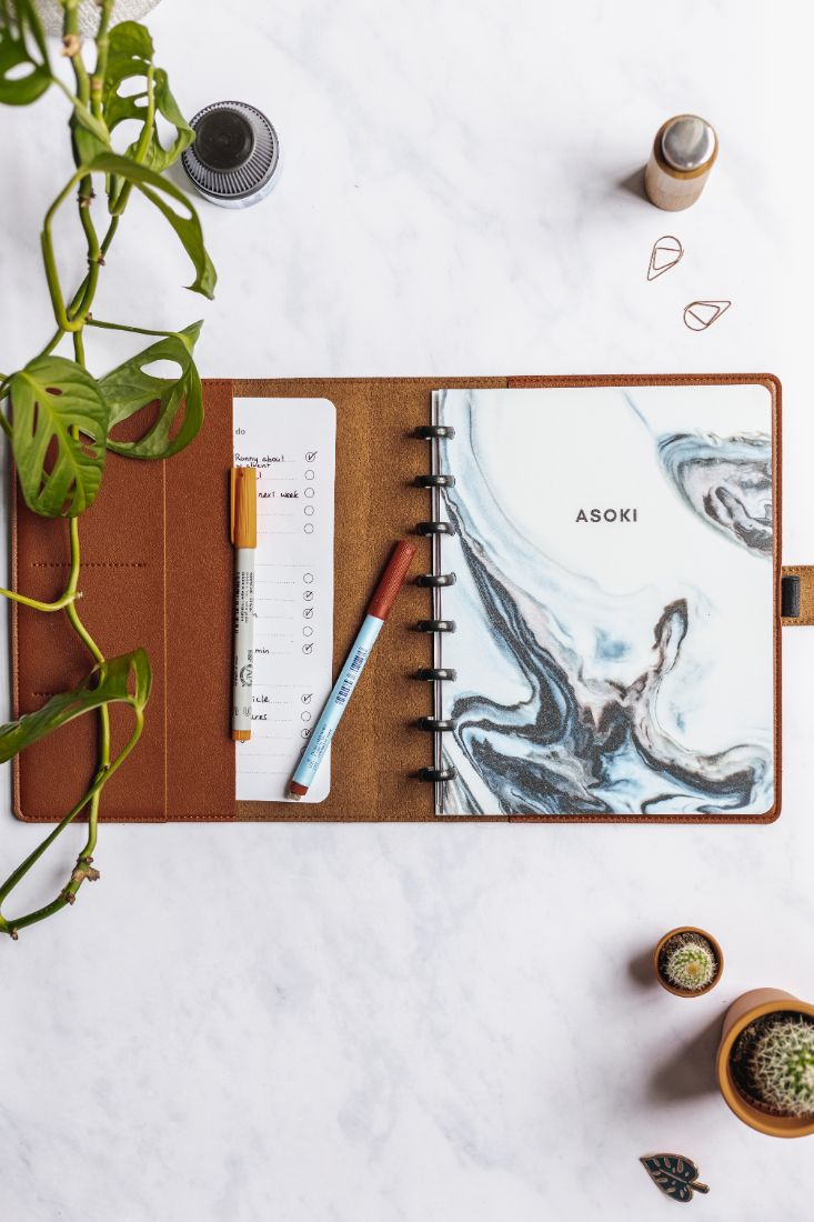 Asoki Planner with a blue marbled cover and a hazelnut case for protection, leather-free