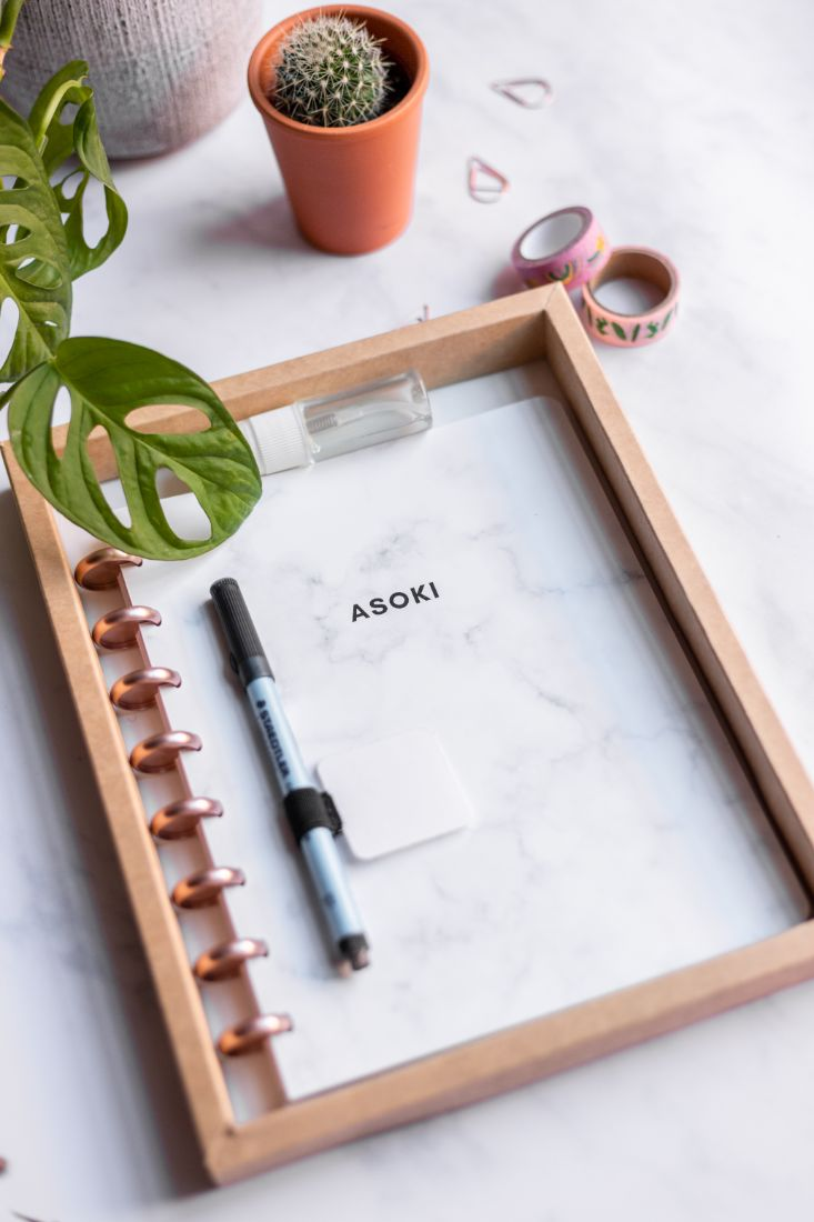 Reusable zero waste Asoki Planner with a white marbled cover and rose gold disc binding, including pen, sticky penloop and spray
