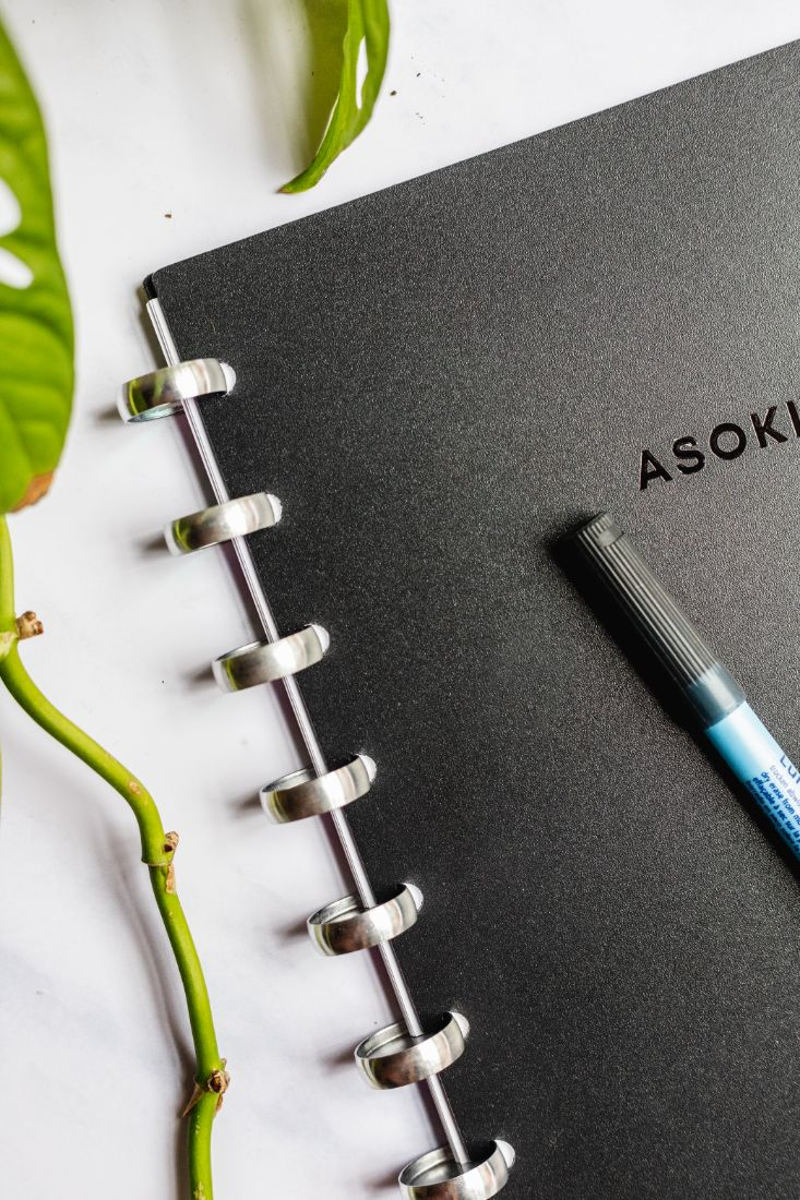 Reusable Asoki planner with black cover and metal disc-binding